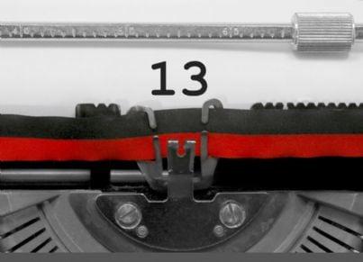 numero tredici su macchina da scrivere