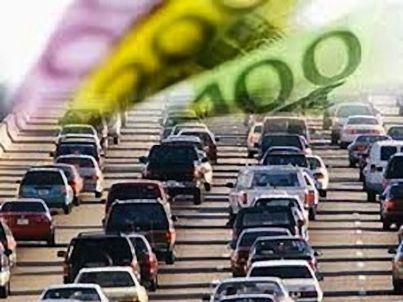 tante auto e euro sullo sfondo