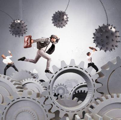uomini affari che si muovono tra difficolta del business