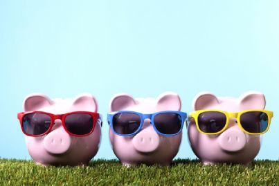 £ salvadanai che esprimono il concetto del sistema bancario