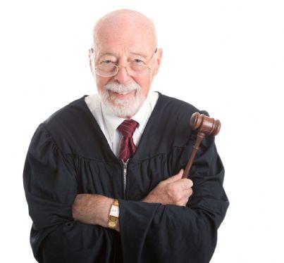 giudice che sorride