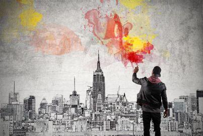 writer inizia a fare graffiti su sfondo cittadino