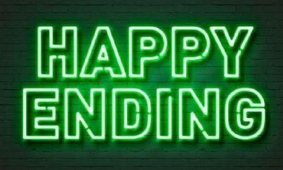 insegna verde con su scritto happy ending