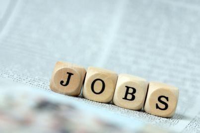 lavoro scritto con dadi su giornale concetto jobs act