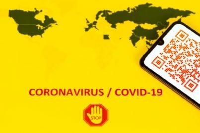 stop covid con sfondo cartina geografica mondiale