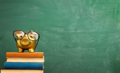 libri scuola con salvadanaio color oro