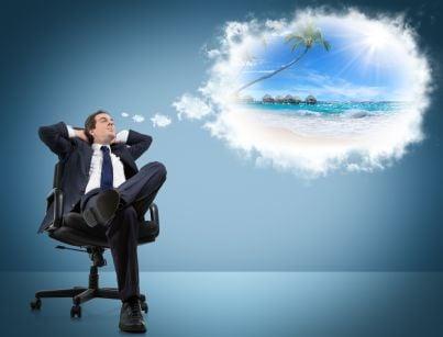 uomo di affari che sogna vacanza